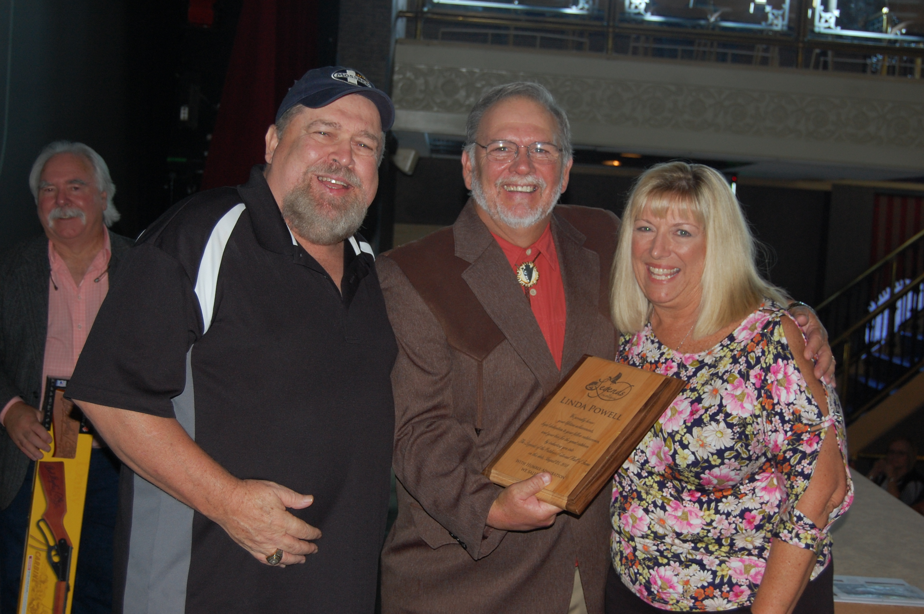 Left to right:  Ray Eye and Garry Mason welcome Linda Powell into the Legends of the Outdoors Hall of Fame