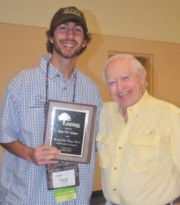 "Wade ""WC"" Hodges accepts the 2016 Lindsay Sale-Tinney Award from legendary angler Stu Tinney at the 2016 SEOPA Conference in Lakeland, Fla."