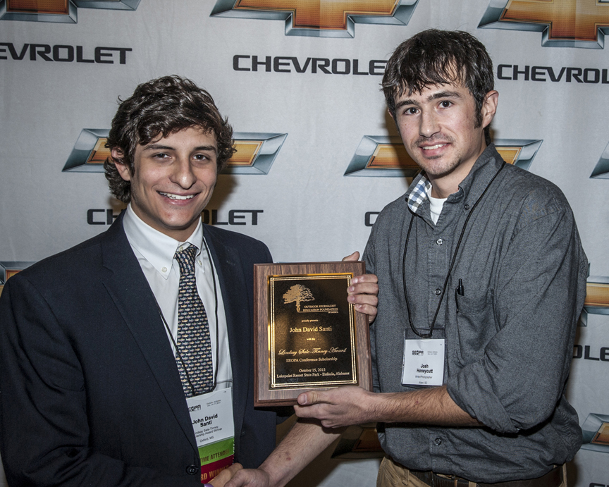 Ole Miss freshman John David Santi, left, accepts the 2015 Lindsay Sale-Tinney Award from 2012 recipient Josh Honeycutt during the recent SEOPA conference in Eufaula, Ala.